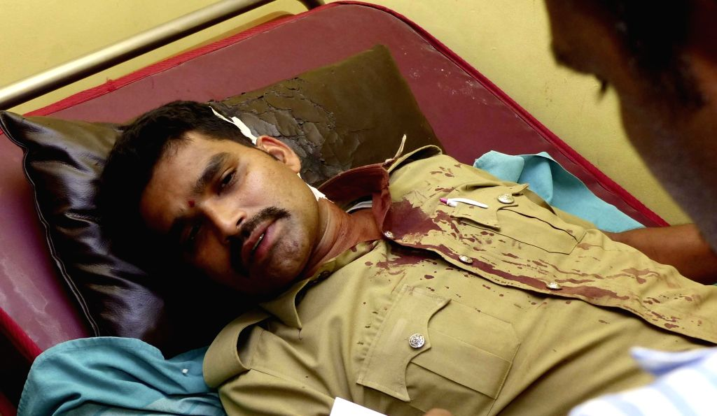 A police personnel who got injured during a demonstration against amendment in Employees Provident Funds and Miscellaneous Provisions Act, 1952 being treated at Bengaluru hospital, on ...