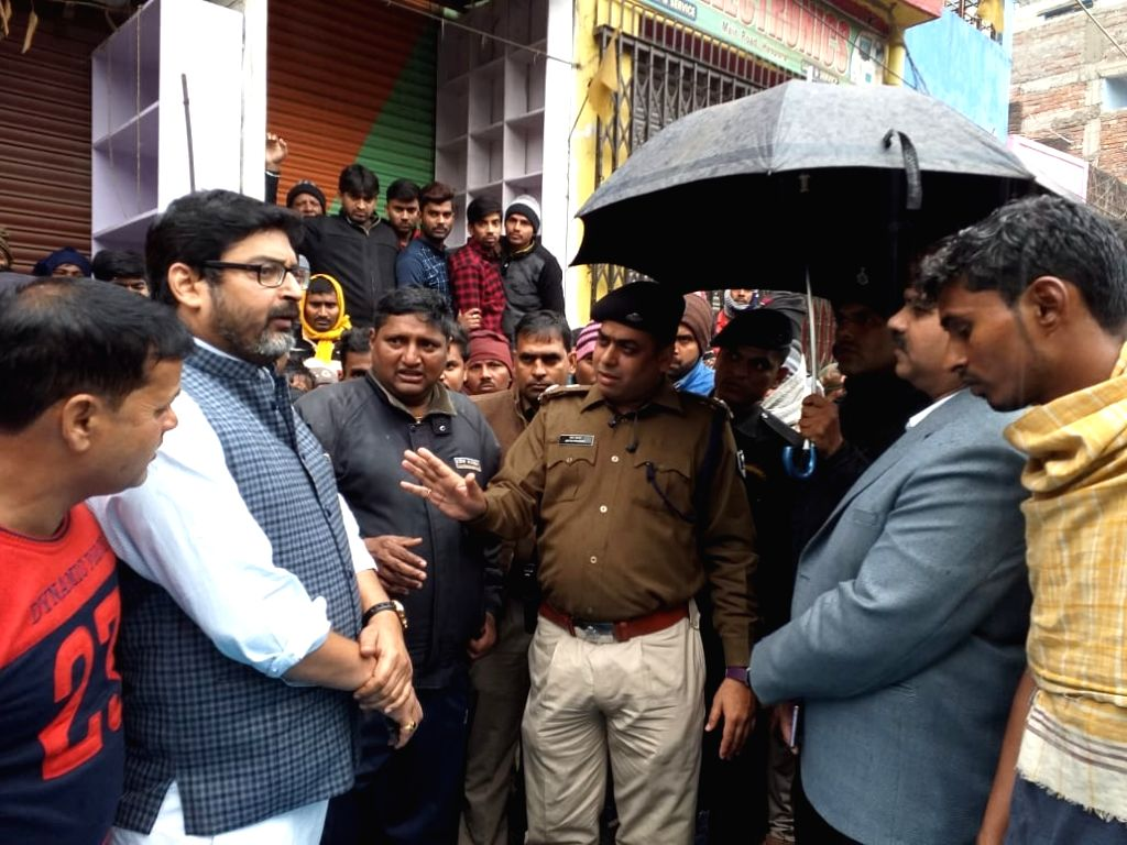 A police personnnel at the site where BJP leader Mohan Yadav was shot dead by unidentified assailants in Bihar's Aurangabad district, on Feb 8, 2019. The incident took place in Haspura ... - Mohan Yadav