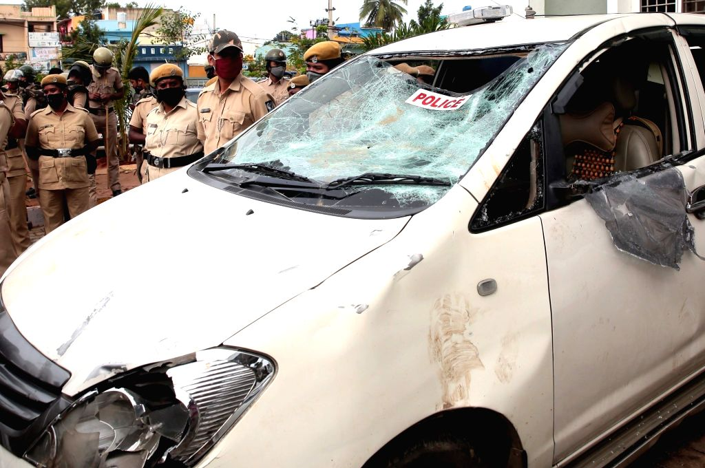 A police van damaged in an attack by an irate mob following an arson late on Tuesday night that resulted after an inflammatory social media post by Congress legislator Akanda Srinivas ...