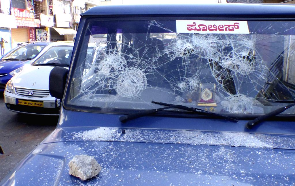 A police vehicle damaged during a demonstration against amendment in Employees Provident Funds and Miscellaneous Provisions Act, 1952 in Bengaluru, on April 18, 2016.