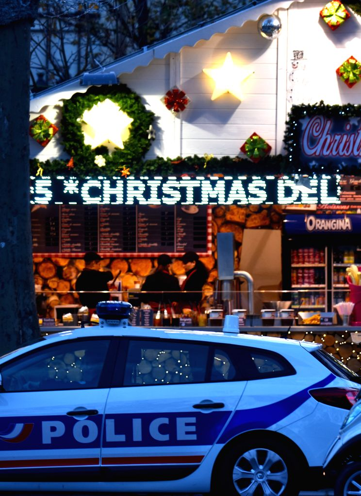 A police vehicle patrols near the Christmas market of the Champs-Elysees Avenue in Paris, capital of France, on Nov. 18, 2015. The Christmas market of the ...