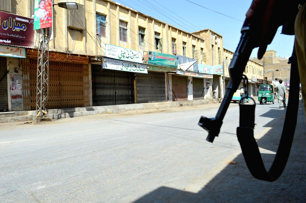 A policeman guards in front of closed shops at a market during a traders' strike in southwest Pakistan's Quetta, Aug. 5, 2015. Traders in major cities of the country ...