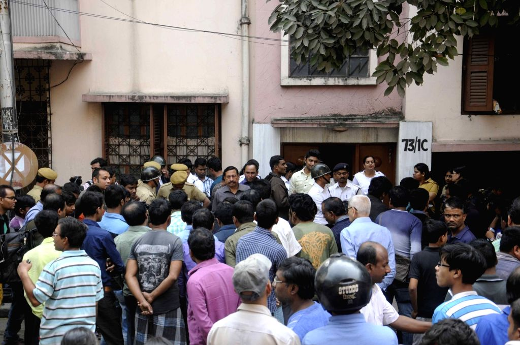 A policeman investigate at the crime scene were bodies of three members of a family, suspected to have been murdered, were found inside an apartment in Kolkata`s Palm Avenue area, on Jan 16, ...
