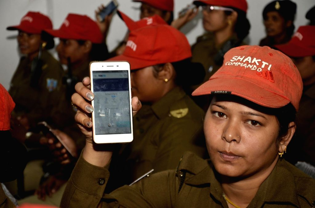 A policewoman shows Paytm app on her smartphone after undergoing a training session on cashless transactions in Ranchi on Nov 29, 2016.
