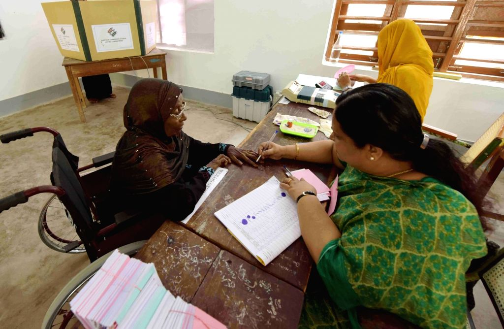 A polling official administering indelible ink to a voter, at a polling booth during the 1st Phase of General Elections-2019 at Agatti Island, Lakshadweep on April 11, 2019.