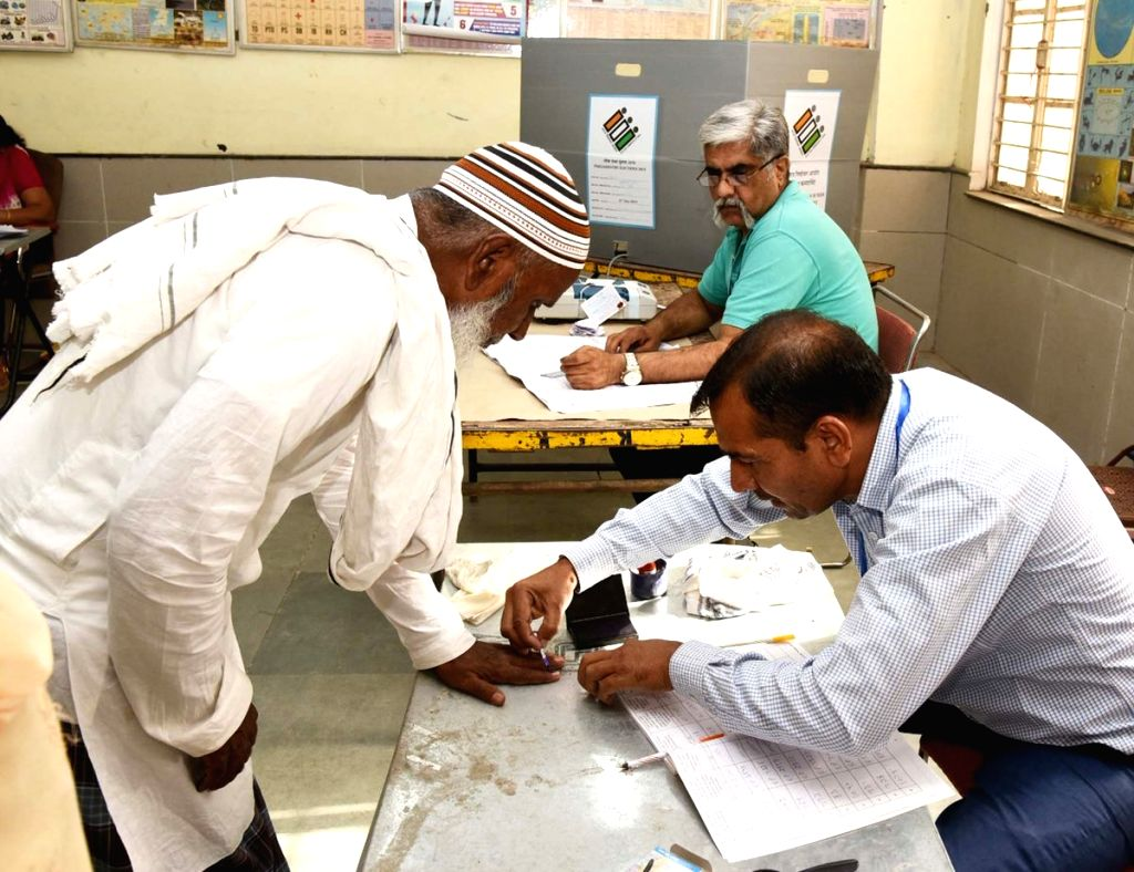 A polling official administers indelible ink on a voter's forefinger, at a polling booth, during the sixth phase of 2019 Lok Sabha elections, in Delhi's Badarpur on May 12, 2019. (Photo: ...