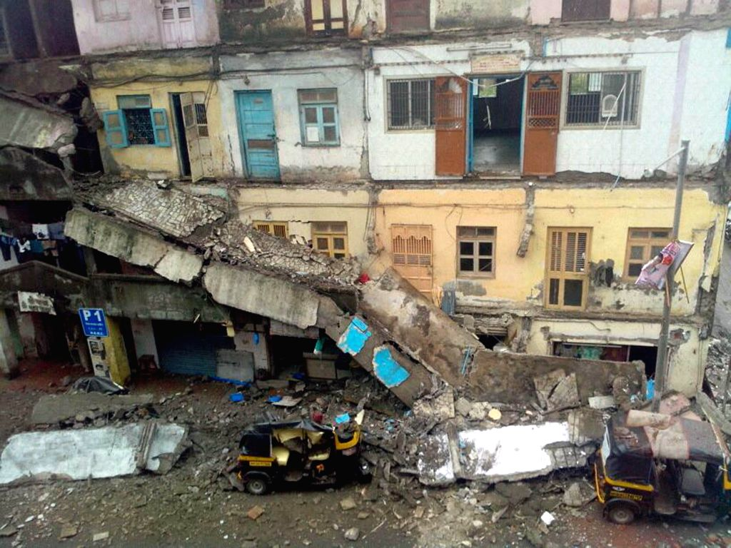 A portion of a building collapses in Bhayandar, near Mumbai on July 13, 2014. Reportedly no one was injured in the accident.