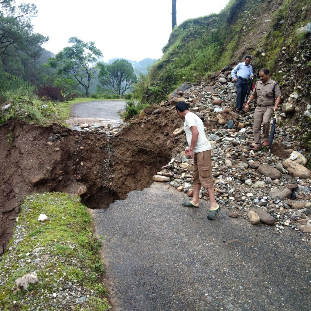 A portion of a road damaged in a cloudburst in Faldia village of Uttarakhand's Chamoli district on Aug 9, 2019.