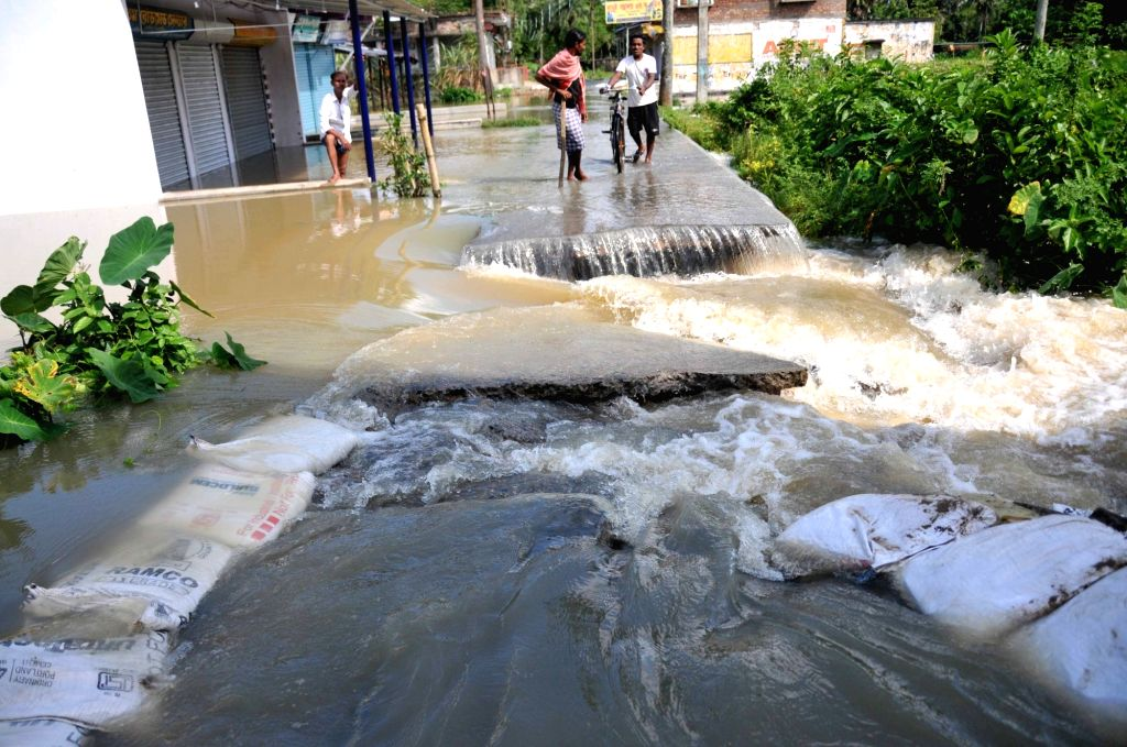 A portion of a road washed away flood affected area in Howrah District West Bengal on Sunday october 03, 2021.
