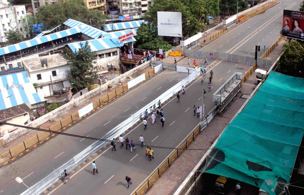 A portion of Lower Parel rail overbridge open to the pedestrians towards eastern side entry, in Mumbai on July 28, 2018. Lower Parel rail overbridge was caved in over the Western Railway (WR) ...