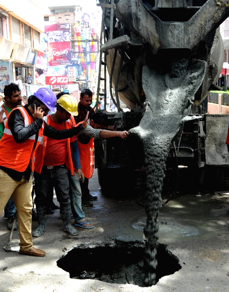A portion of the Kempegowda Road caved in near the underground section of Namma Metro which passes under the area was filled with concrete to close the sinkhole, in Bengaluru on Aug 2, ...