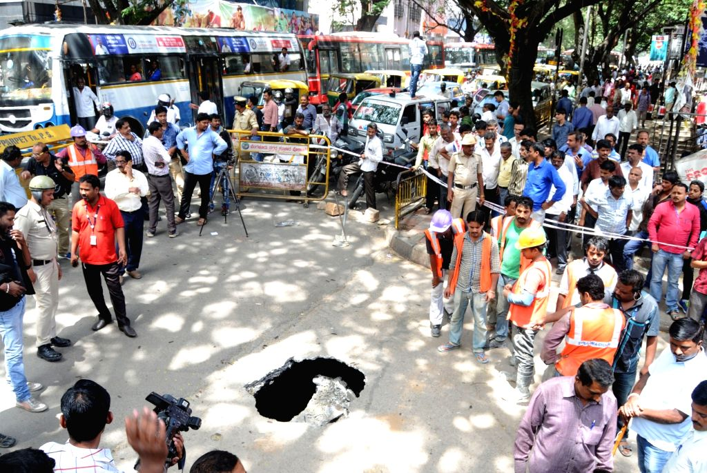 A portion of the Kempegowda Road caved near the underground section of Namma Metro which passes under the area, in Bengaluru on Aug 2, 2016.
