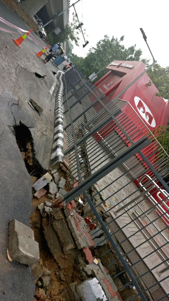 A portion of the road outside the newly-built Greater Kailash Metro Station on Magenta Line that caved in, in New Delhi on July 20, 2018.