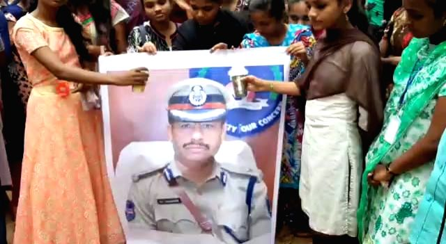 A portrait of Cyberabad Police Commissioner V. C. Sajjanar being washed with milk after the police shot dead all the four accused in gang rape and murder of a young veterinarian in ... - Ranga Reddy