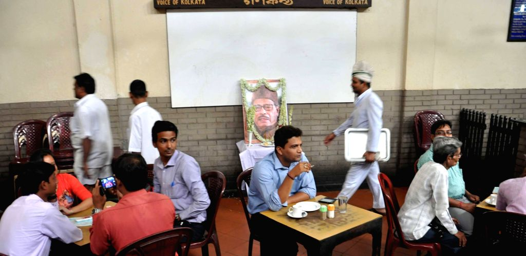 Portraits of legendary singer Manna Dey placed in Coffee House