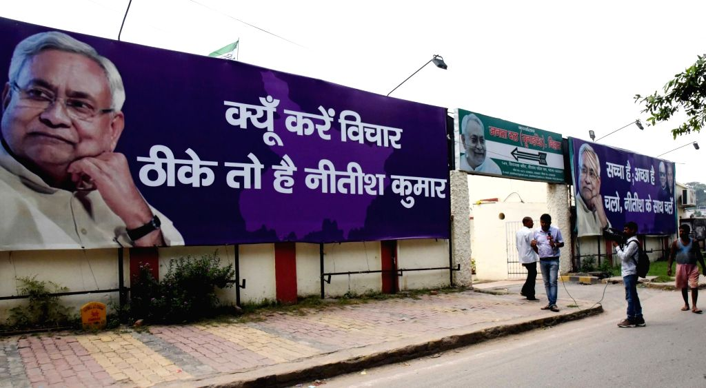 "A poster of JD-U comes up at a Patna street with the new slogan ""Kyun Kare Vichar, Thhike Toh Hai Nitish Kumar"" ahead of 2020 Bihar Assembly elections, on Sep 3, 2019."