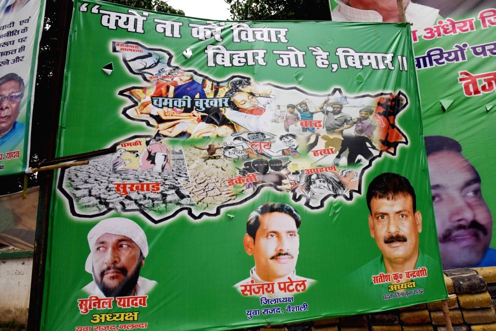 """A poster of RJD comes up at a Patna street with the new slogan """"Kyun Na Karen Vichaar, Bihar Jo Hai Beemar"""" ahead of 2020 Bihar Assembly elections, on Sep 3, 2019."""