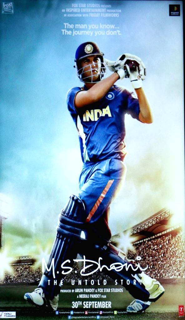 A poster of the film M S Dhoni during the screening, in Mumbai, on Sept 29, 2016.