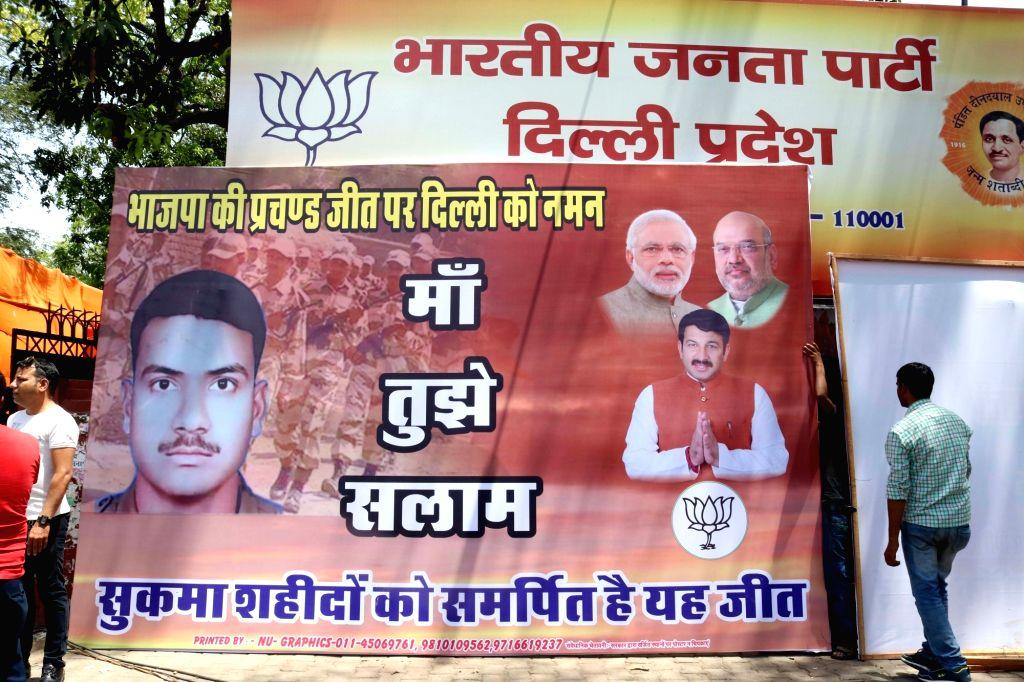 "A poster outside Delhi BJP office dedicates party's ""victory"" in Delhi MCD polls to marty of Sukma in New Delhi, on April 25, 2017."