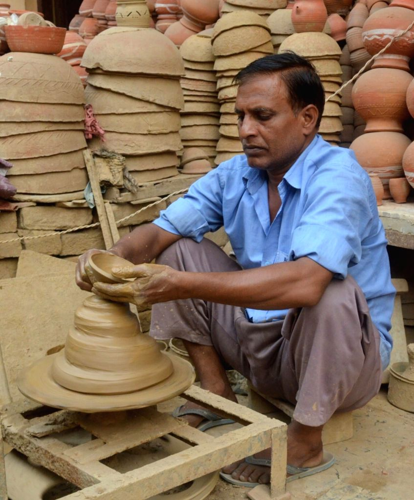 A potter busy making earthen lamps ahead of Diwali - festival of lights in Ghaziabad, on Oct 12, 2017.