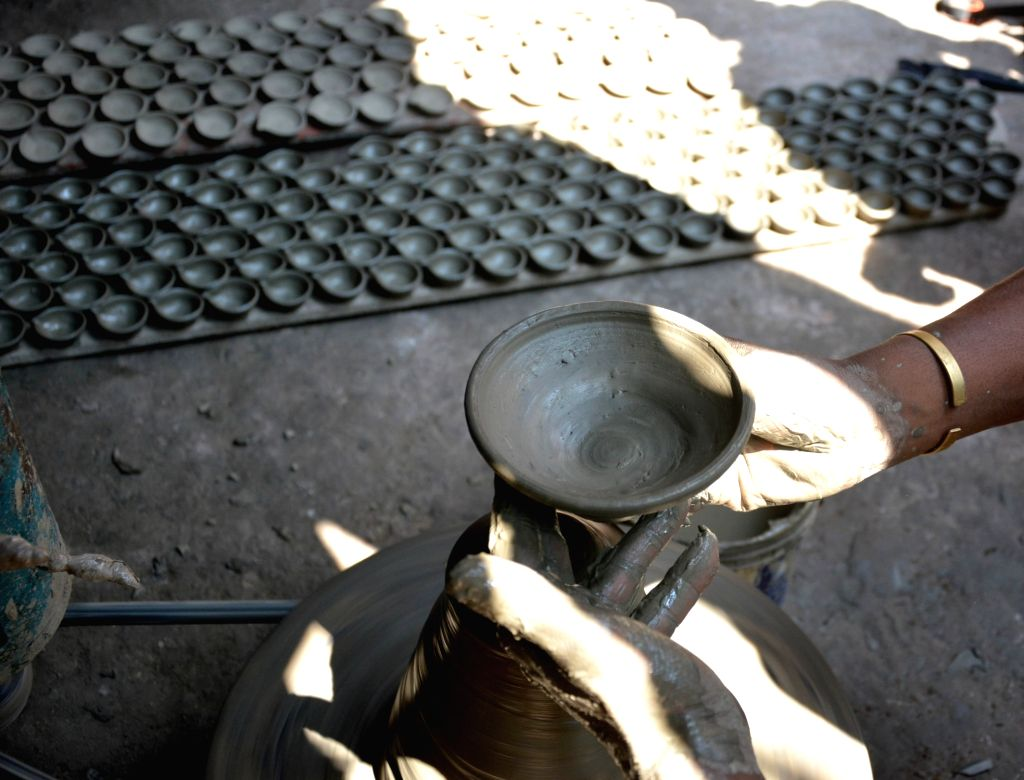 A potter busy preparing earthen lamps ahead of Diwali in Kolkata on Oct 11, 2017.