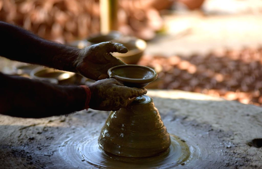 A potter makes an earthen lamp ahead of Diwali, in Guwahati on Oct 25, 2018.