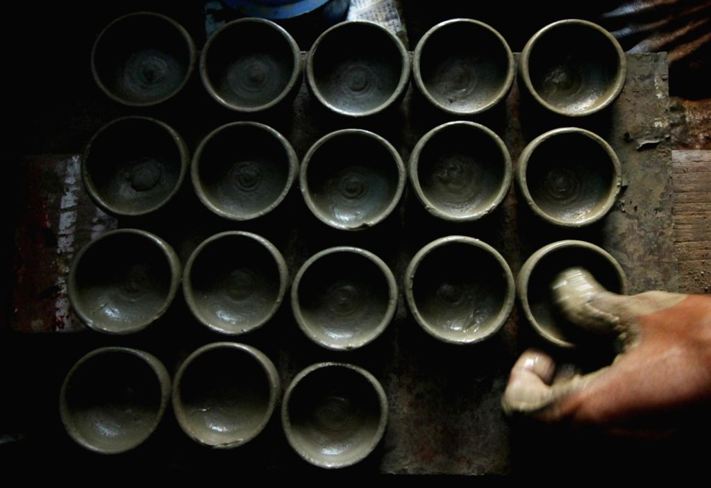 A potter makes earthen lamps ahead of Diwali in Chennai, on Oct 21, 2016.