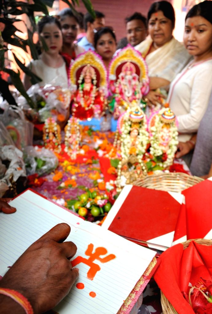 A priest performs a ritual during Bengali New Year celebrations in Kolkata, on April 15, 2019.