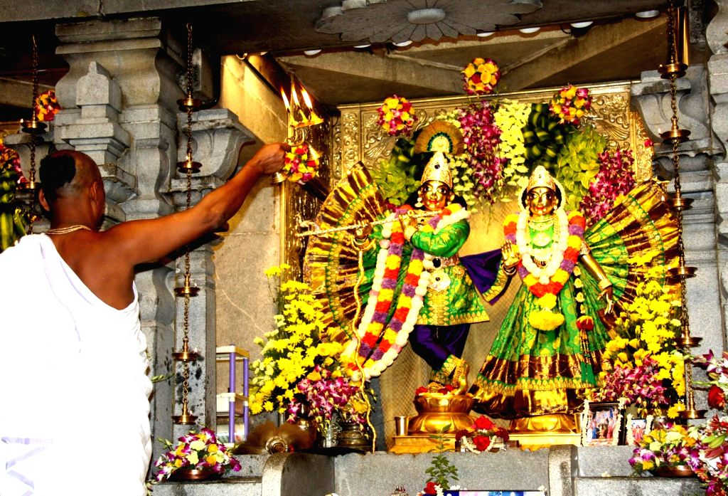 A priest performs 'arti' of Lord Krishna at ISKCON temple on the eve of Janmashtami, in Bengaluru on Sept 2, 2018.
