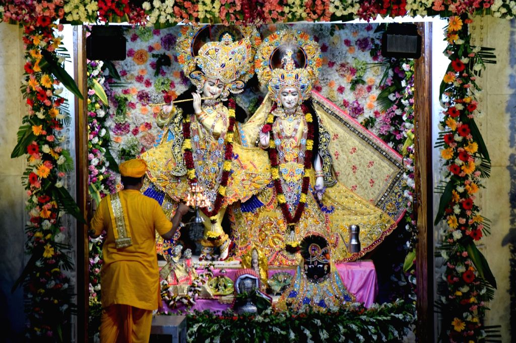 A priest performs 'Maha Aarti' of Lord Krishna and Radha at Shri Krishna Janmasthan Temple during Krishna Janmashtami celebrations, in Mathura on Aug 12, 2020.