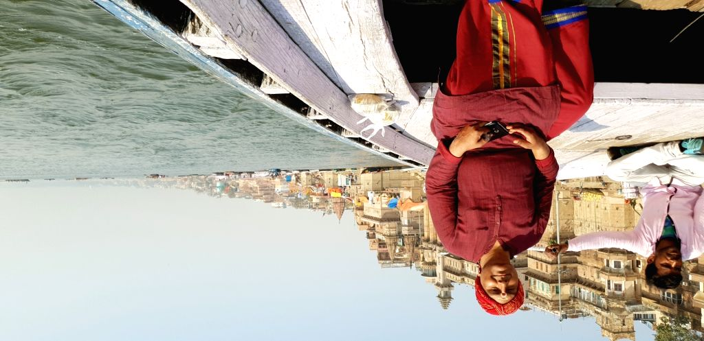 A priest poses for a picture on a boat in Varanasi.