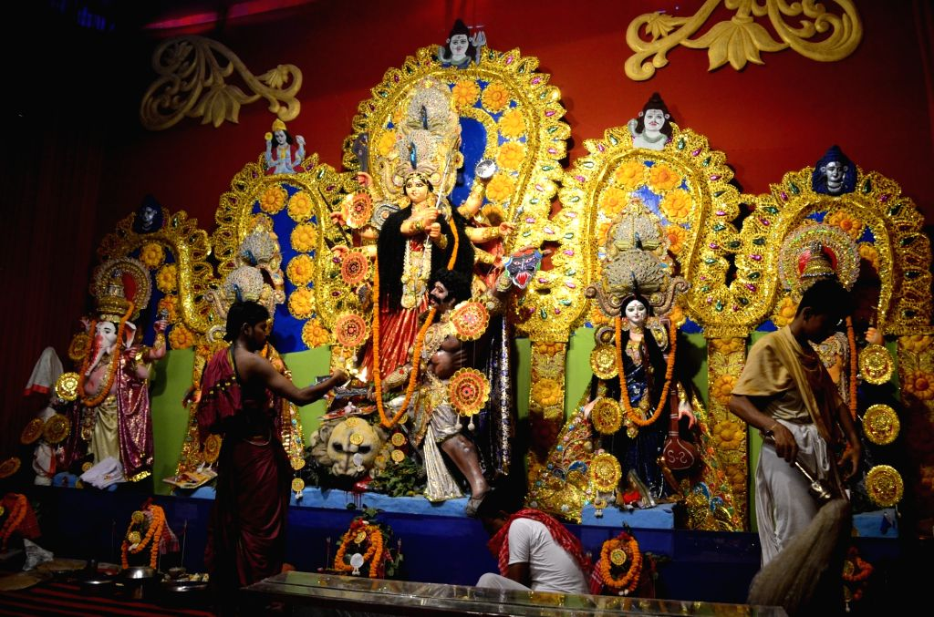 A priest worships Goddess Durga at a pandal in Allahabad on Oct 8, 2016.