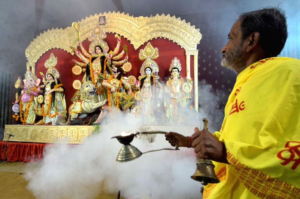 A priest worships goddess Durga during Durga Puja in Jaipur, on Oct 7, 2016.