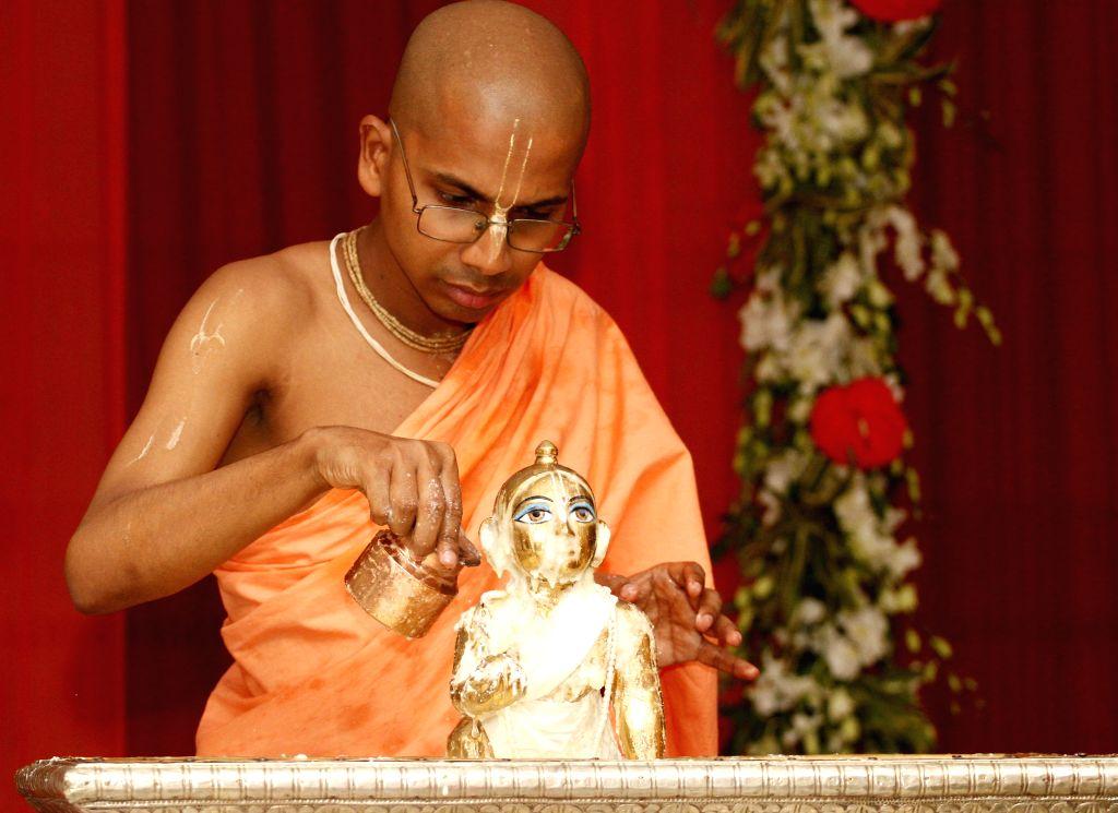 A priest worships lord Krishna on Janmashtami at ISKCON Temple in New Delhi on Aug 18, 2014.