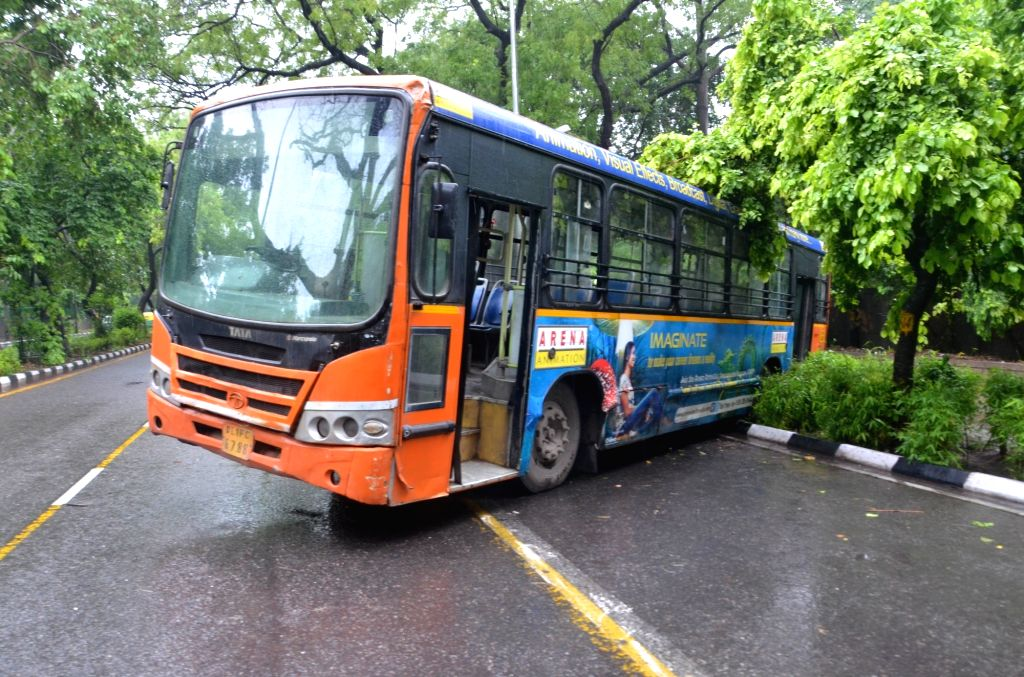 A private bus skids off the road due to heavy rainfall in New Delhi on July 16, 2016.