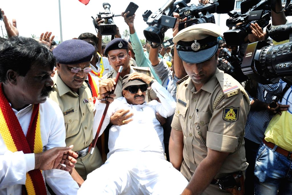 A pro-Kannada activist being taken away by police during a demonstration over Cauvery water dispute, in Bengaluru on April 5, 2018.