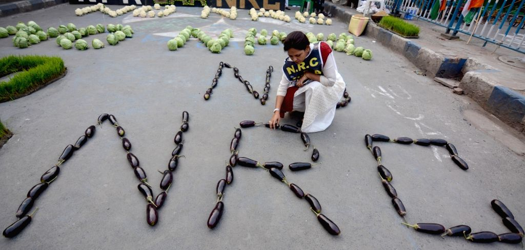"""A protester arranges vegetables in the formation of """"NO NRC"""" at a Kolkata street during a demonstration against the Citizenship Amendment Act (CAA) 2019, National Register of ..."""