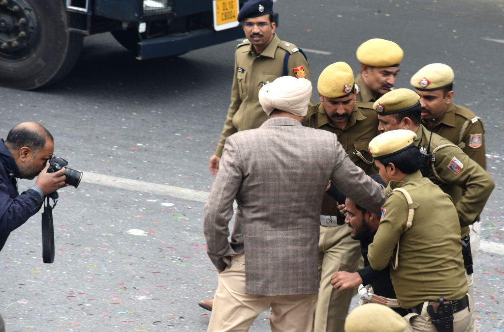 A protester detained by the police during a protest march organised to express support to Delhi Commission for Women (DCW) chief Swati Maliwal who is on an indefinite hunger strike ...