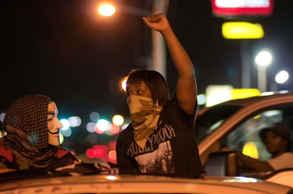 A protestor is seen during a manifestation in Ferguson, the United States, on Aug. 11, 2015. Protests marking the anniversary of the shooting of unarmed ...