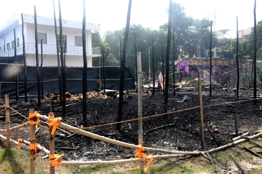 A puja pandal at Salt Lake's FD block that was gutted by fire before Durga idol immersion, in Kolkata on Oct 28, 2020. Nobody was injured, but the pandal was totally gutted. The blaze was ... - Sujit Bose