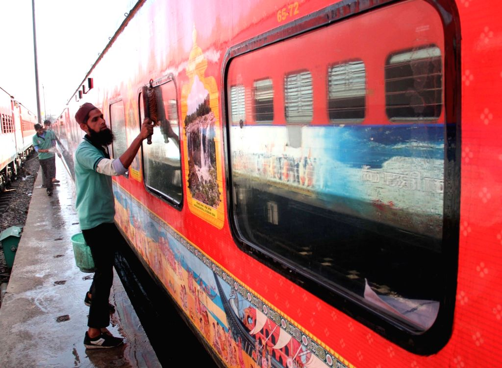 A railway coach being cleaned as part of a sanitisation drive being conducted as a measure to contain the spread of COVID-19 amid coronavirus pandemic, at the New Delhi Railway Station on ...