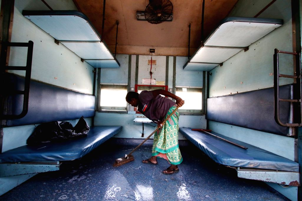 A railway worker mopping and sanitising train at Chennai Railway Station amid outbreak of COVID-19 (coronavirus), on 19 March, 2020.