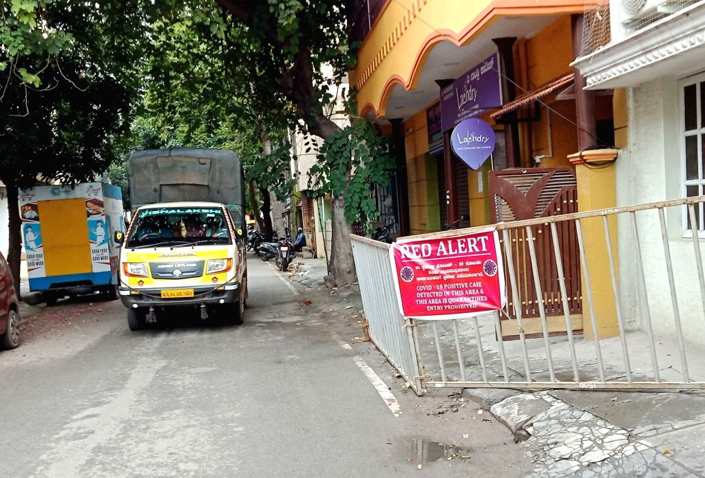"""A """"Red Alert"""" banner put up by the Bruhat Bengaluru Mahanagara Palike (BBMP) outside a house after several COVID-19 cases were detected in Bengaluru's Okalipuram, on Aug 4, 2020. ..."""