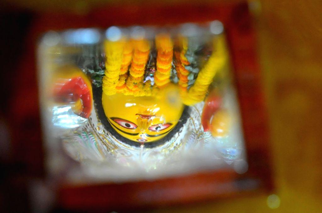 A reflection of an idol of goddess Durga seen in the mirror during Dashami Puja in Kolkata on Oct 26, 2020. Maha Dashami starts with usual rituals including darpan visarjan or the symbolic ...