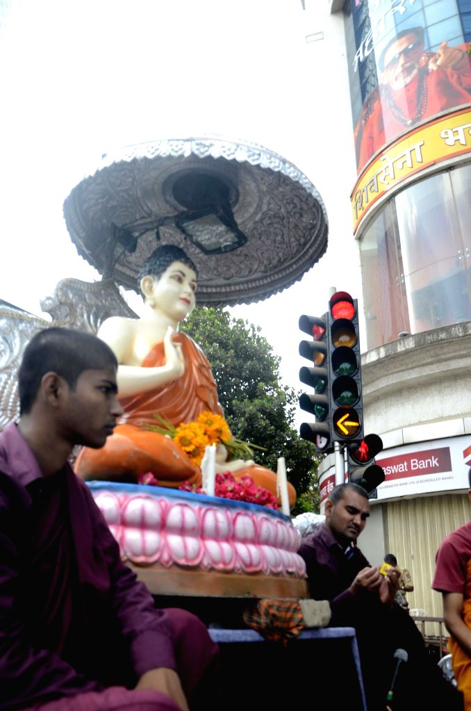 A religious procession organised on 2558th birth anniversary of Lord Buddha in Mumbai on May 14, 2014. Buddha Purnima is the most sacred day in the Buddhist calendar and celebrated on the full-moon ..