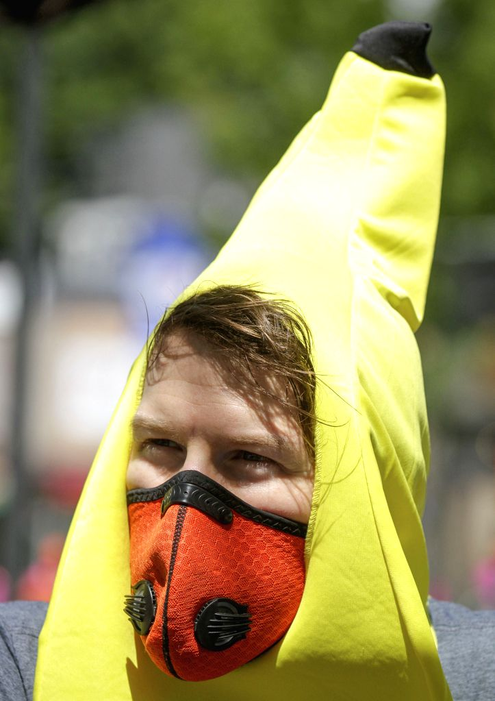 A resident wearing a face mask is seen in Vancouver, British Columbia, Canada, on July 12, 2020. In the past week, the number of new cases in British Columbia has ...
