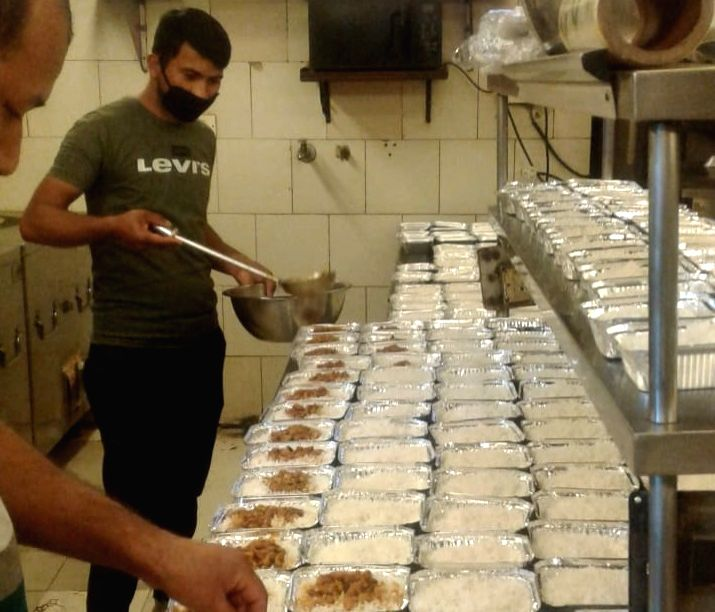 A restaurant in Delhi's Connaught Place serves free food to guards and policemen during nationwide lockdown imposed to contain the spread of coronavirus.
