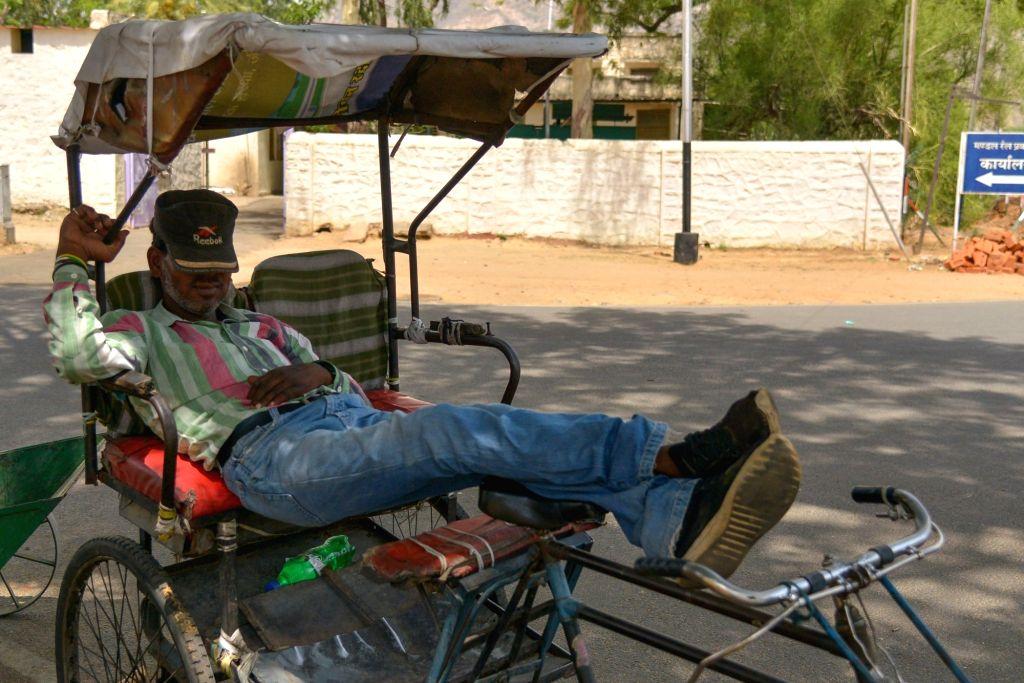 A rickshaw puller enjoys his siesta on a hot summer day in Ajmer on June 7, 2019.