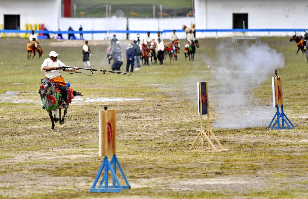 A rider competes during a horse racing event in Nagqu of southwest China's Tibet Autonomous Region, Aug. 11, 2020.