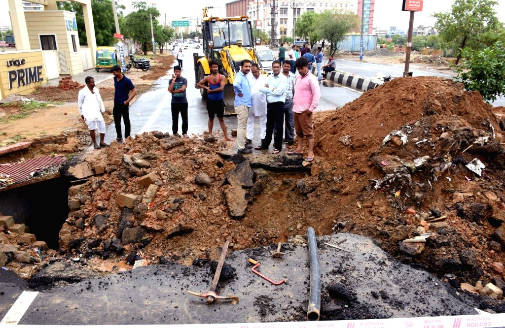 A road caves in at Mansarovar following heavy rains, in Jaipur on July 26, 2019.